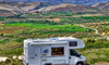 an RV with a landscape in the background