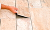 Worker Placing tiles