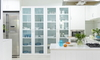 A room with glass cabinets.