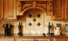 kitchen with custom wooden cabinets and natural toned tile backsplash