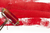paint on roller with dark marks on white surface