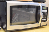 The front to a microwave oven.