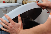 Man working on a water softener