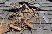 old shingles coming off roof