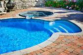 A pool with a fiberglass pool shell.
