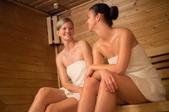 two women sitting in a sauna