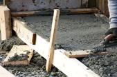 pouring concrete into a wooden frame