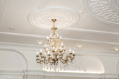 chandelier hanging from a white ceiling