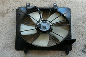 radiator fan laying on the ground