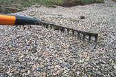 raking a gravel driveway