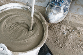 Mixing concrete in a bucket