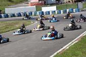 several racers on a go kart track