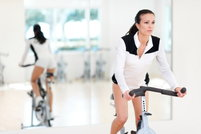 Young Woman On Exercise Bike