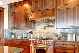 A kitchen with wood cabinets.