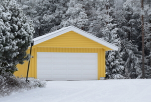 yellow garage in snowy woods