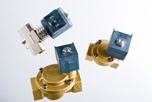 Three isolated solenoid valves against a gray background.