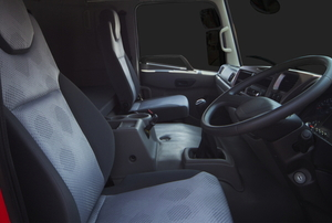 red truck interior front seats with steering wheel