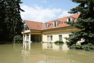 house with flooding waters surrounding it