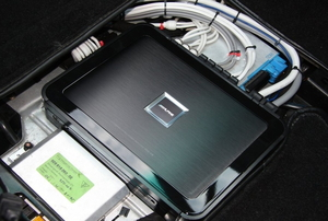 An installed car radio amplifier.