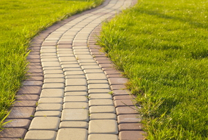 A brick path surrounded by grass.