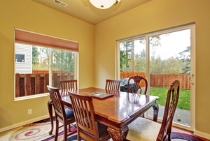 Dining room with large window and glass door
