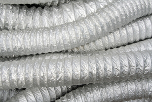 Several tubes of flexible ducting in a pile.
