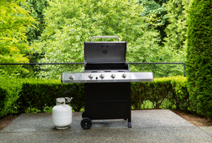 a grill and propane tank on a patio