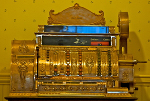 A brass cash register.