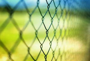 A close shot of a chain link fence.