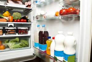 An open refrigerator filled with food.