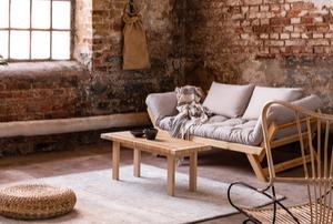 bohemian wabi sabi living space with exposed brick and large window