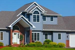 a blue, suburban house