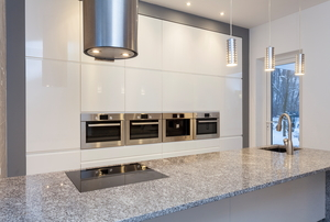 A light-colored granite countertop in a modern kitchen.