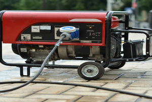 A portable generator with a cord coming out the front.