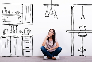 A woman sitting in a cartoon drawing of a kitchen.