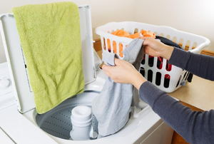 A woman washing clothes.
