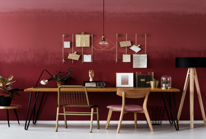 A red and pink ombre wall in a dining room.