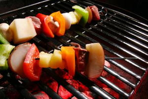 food on a grill with hot coals underneath