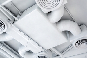 a large ventilation system on a white ceiling