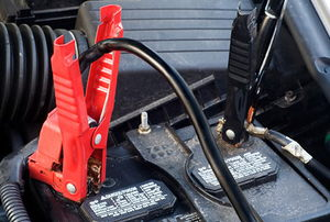 Closeup of Jumper Cables on Automobile Battery