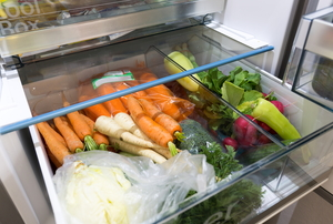 A refrigerator drawer full of produce.