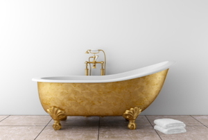 Freestanding bathtub with a gold-colored finish