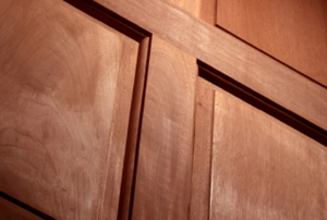 A raised-panel, interior door made with mahogany wood.