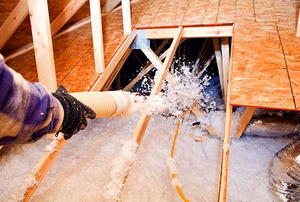A point-of-view look at installing blown-in attic insulation.