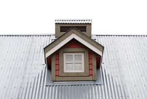 An aluminum roof around a small window.