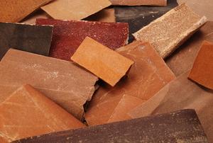 A pile of assorted sandpaper scraps.