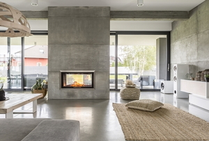 contemporary living room with concrete fireplace and natural tones