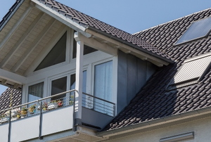 metal gable roof with second floor balcony