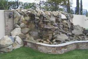 concrete waterfall in a backyard