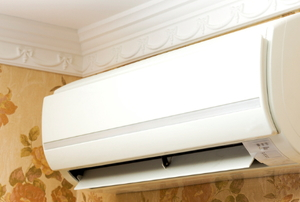 An AC splitter unit mounted on a wall.